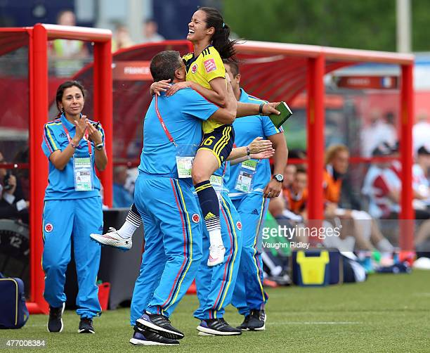 Lady Andrade of Colombia celebrates her goal with coaches during the FIFA Women's World Cup Group F match between France and Colombia at Moncton...