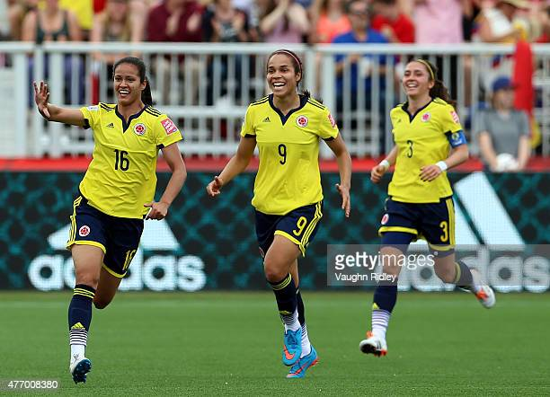 Lady Andrade of Colombia celebrates her goal with Orianica Velasquez and Natalia Gaitan during the FIFA Women's World Cup Group F match between...