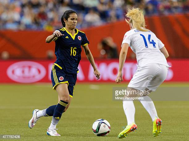 Lady Andrade of Colombia tries to move the ball past Alex Greenwood of England during the 2015 FIFA Women's World Cup Group F match at Olympic...