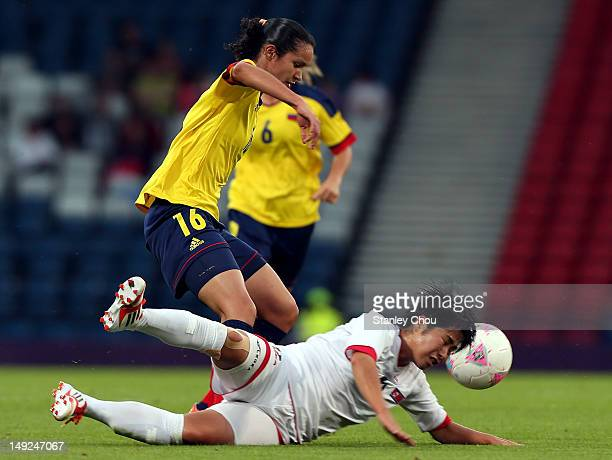 Lady Andrade of Columbia tackles Choe Un Ju of DPR Korea during the Women's Football first round Group G Match of the London 2012 Olympic Games...