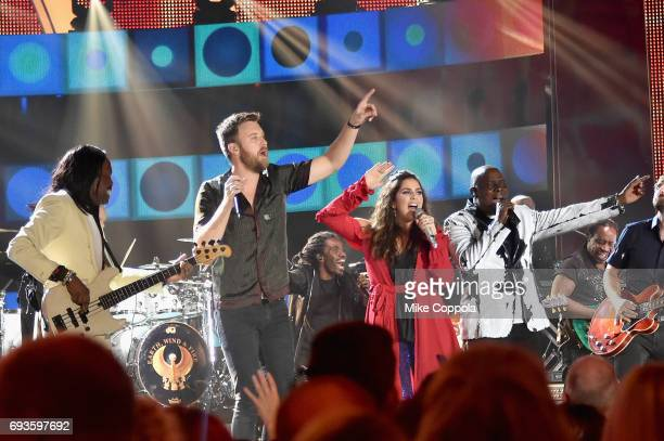 Lady Antebellum and EarthWind Fire Verdine White Charles Kelley Hillary Scott and Ralph Johnson perform onstage during the 2017 CMT Music Awards at...