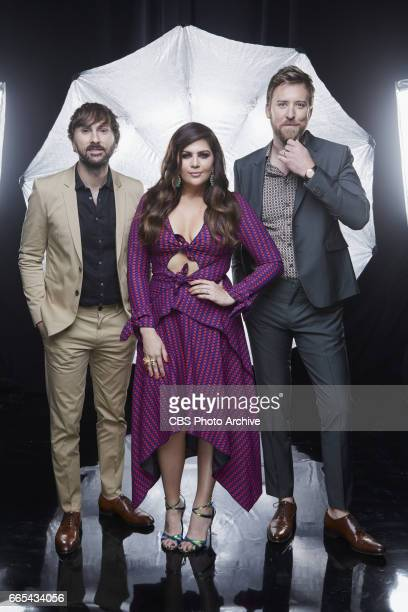 Lady Antebellum pose for a photograph in the CBS Photo Booth backstage at THE 52ND ACADEMY OF COUNTRY MUSIC AWARDS broadcast LIVE from TMobile Arena...