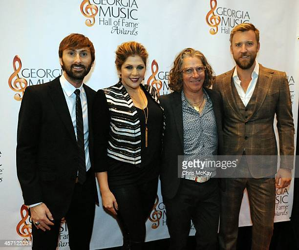 Lady Antebellum's Dave Haywood Hillary Scott and Charles Kelly greet fellow inductee Ed Roland of Collective Soul at the 36th annual Georgia Music...
