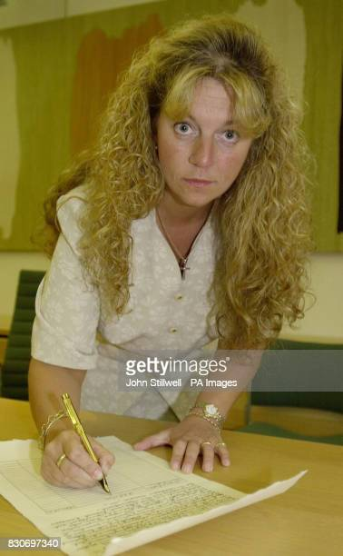 Lady Apsley at Portcullis House London signing a petition at the launch of a campaign by a group of MPs and celebrities for a full public inquiry...