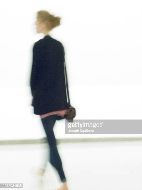 lady at museum,out-of-focus - joseph squillante stock pictures, royalty-free photos & images