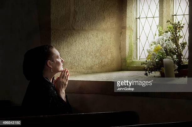 Lady at prayer