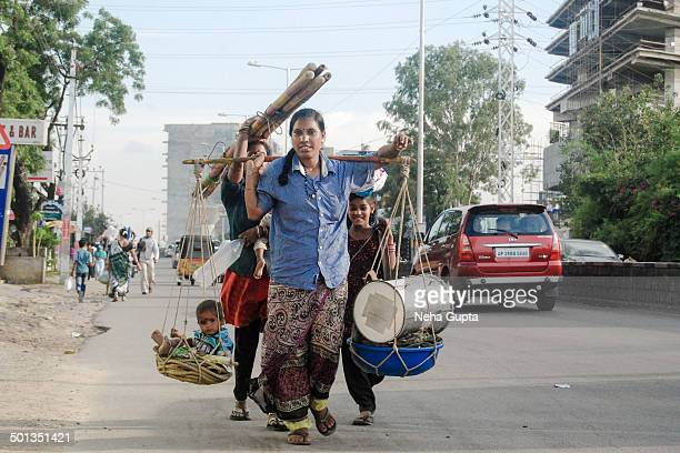 CONTENT] A lady balancing her child goods over her shoulders