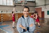 Lady basketball coach on court