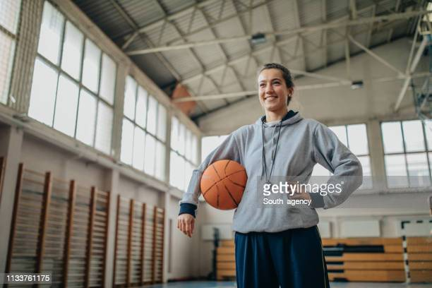 lady basketball coach on court with a ball - whistle stock pictures, royalty-free photos & images