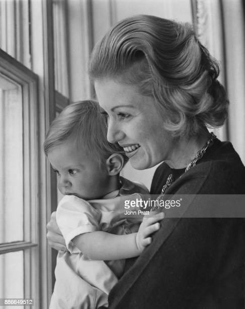 Lady Bathurst née Judith Mary Nelson the wife of Henry Bathurst 8th Earl Bathurst with her oneyearold son Allen Lord Apsley at the family seat...