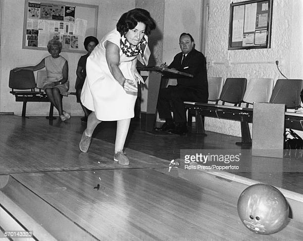 Lady Bird Johnson wife of former United States President Lyndon B Johnson pictured enjoying a game of ten pin bowling following her husband leaving...