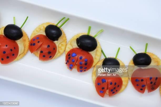 lady bugs crackers appetizers - rafael ben ari imagens e fotografias de stock