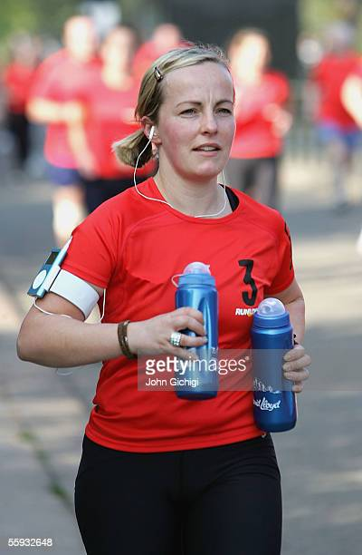 A lady caries two bottles as she runs the Nike 10K at Hyde Park on October 16 2005 in London England Over 32000 participants joined World Champion...