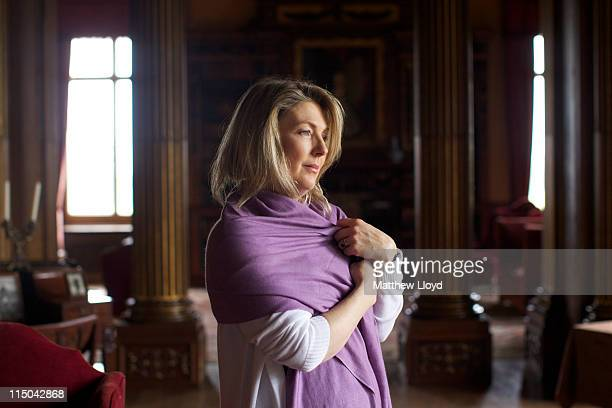 Lady Carnarvon poses in the library of Highclere Castle on March 15 2011 in Newbury England Highclere Castle has been the ancestral home of the...