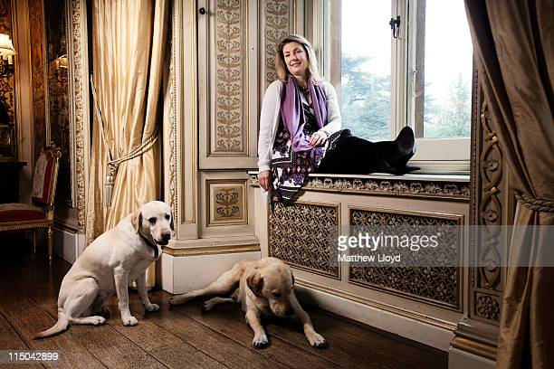 Lady Carnarvon relaxes in the music room of Highclere Castle on March 15 2011 in Newbury England Highclere Castle has been the ancestral home of the...
