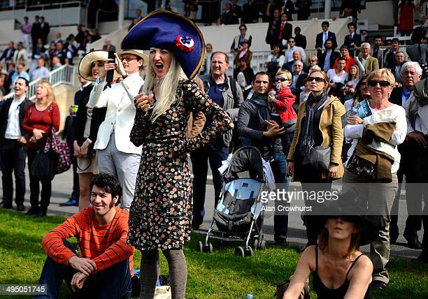 A lady cheers on her horse at Chantilly racecourse on June 01 2014 in Chantilly France