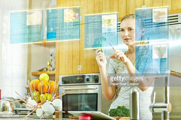 Lady choosing from a list of hologram recipes