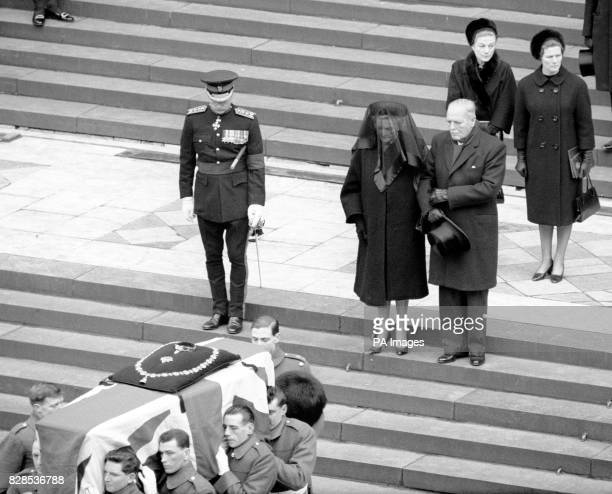 Lady Churchill places her arm in that of her son Randolph Churchill as they walked slowly down the steps of St Paul's Cathedral behind the coffin of...