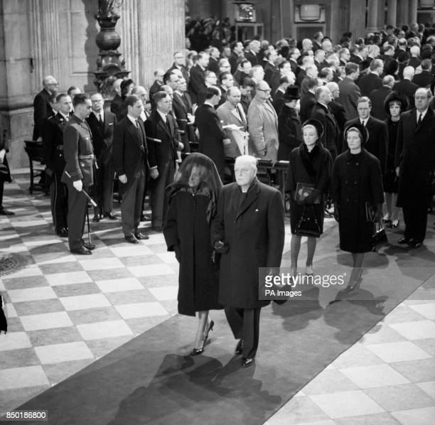 Lady Churchill takes the arm of her son Randolph at the head of the family mourners as they follow the coffin from St Paul's Cathedral after the...