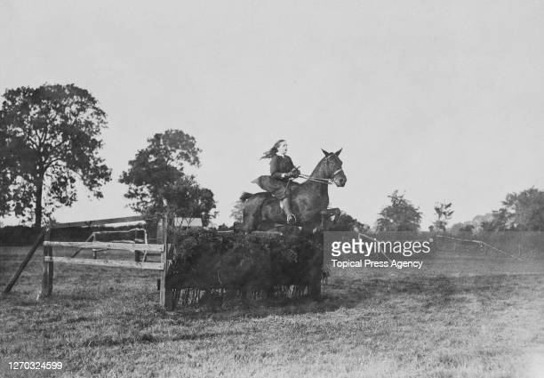 Lady Clare clears a hedge at a children's gymkhana and sports day in Rugby England 13th September 1912