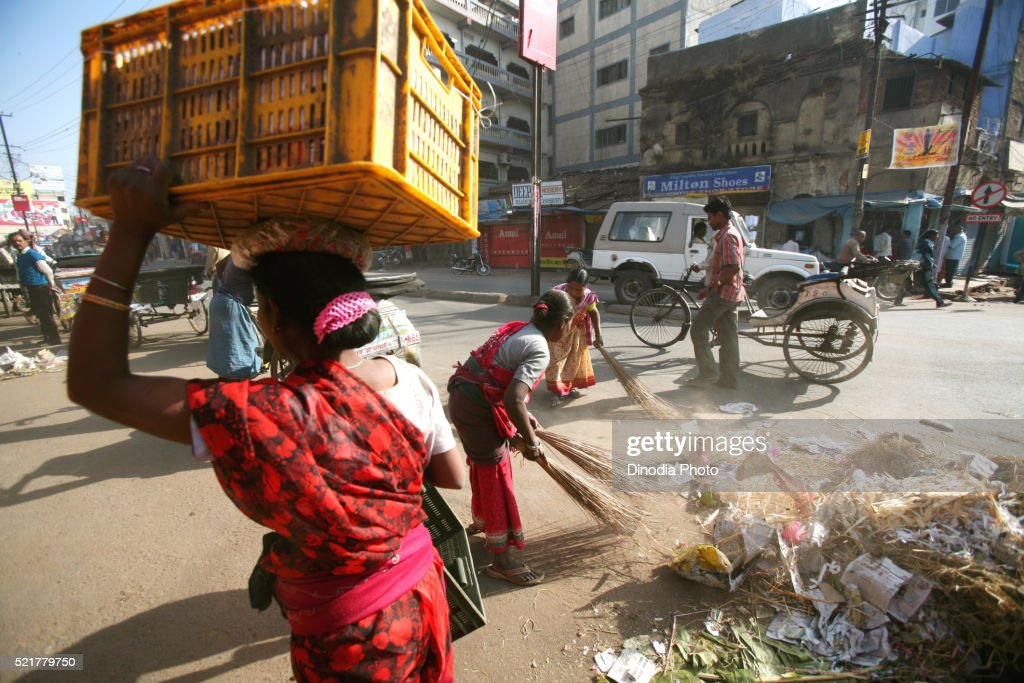 Lady cleaning road in Ranchi city capital of Jharkhand, India : Stock Photo