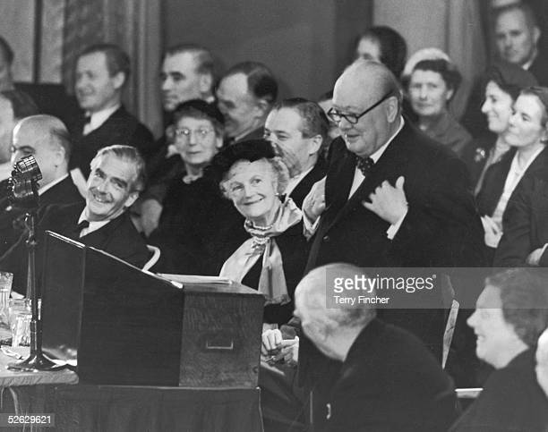 Lady Clementine Churchill and Anthony Eden look on as British Prime Minister Winston Churchill addresses the Conservative Party conference in Margate...