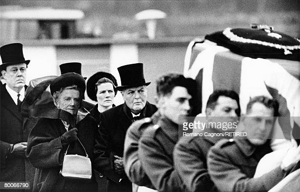Lady Clementine Churchill is escorted on the arm of her son Randolph as they follow the coffin of her husband, British statesman Winston Churchill at...