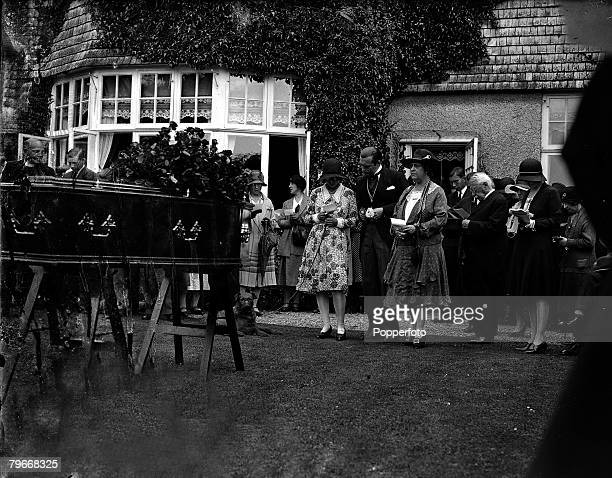 Lady Conan Doyle right with son Adrian and one of her daughters at the funeral of Sir Arthur Conan Doyle the creator of Sherlock Holmes Windlesham...