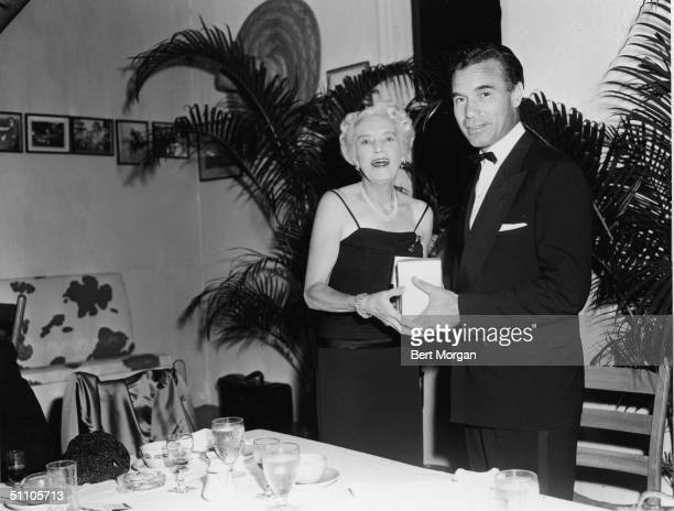Lady Cyril Kenilworth and Dominican diplomat and socialite Porfirio Rubirosa pose together at the Palm Beach Polo Club Palm Beach Florida 1950s