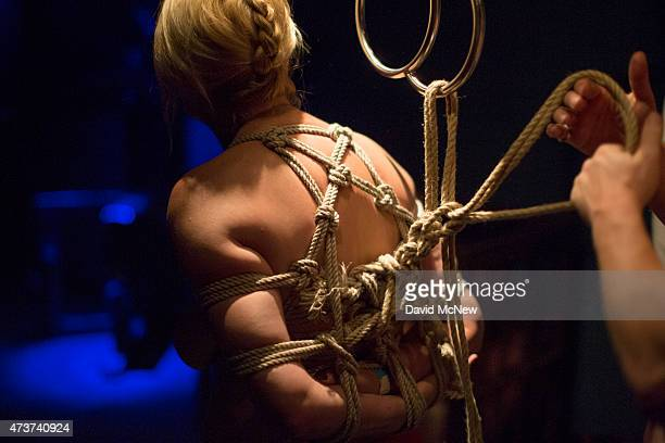 Lady Dalbin is tied up by Michael Lumos for her enjoyment at a dungeon party during the domination convention DomCon LA on May 16 2015 in Los Angeles...