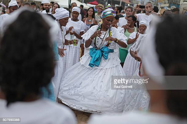 Lady dancing at Rio Vermelho beach to celebrate Yemanja day on February 2 2016 in Salvador Brazil Yemanja is a powerful goddess of the sea in the...