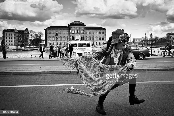 Lady dancing in the street with a scarf