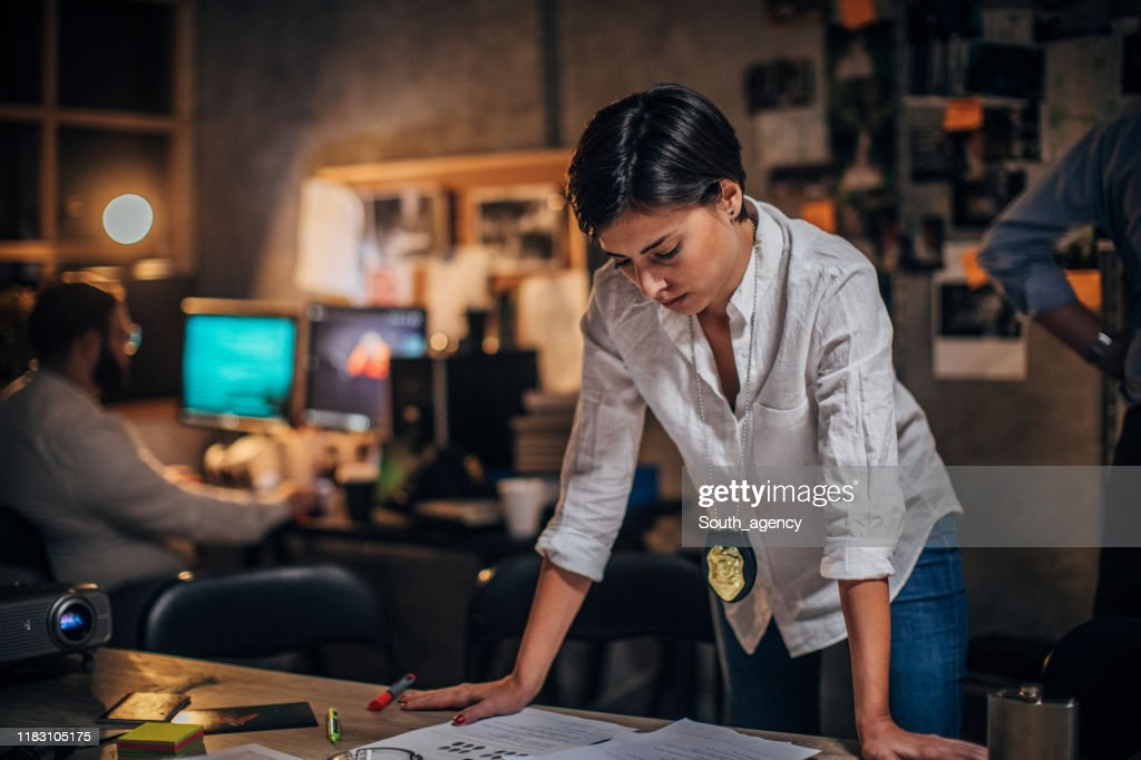Lady detective looking for clues on a crime case : Stock Photo