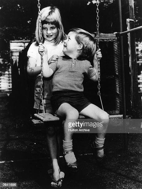 Lady Diana Frances Spencer playing with her brother Charles Edward Maurice the Viscount Althorp in the grounds of Park House Sandringham when she was...