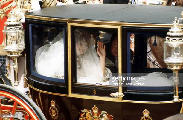 Lady Diana Spencer and her father Earl Spencer travel by coach to St Paul's Cathedral for her wedding to the Prince of Wales, 29th July 1981. She...