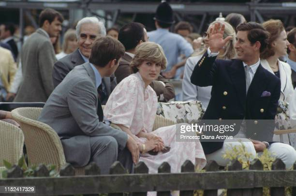 Lady Diana Spencer and her fiancé Prince Charles attend the Cartier International polo match on Smith's Lawn, Windsor, three days before their...