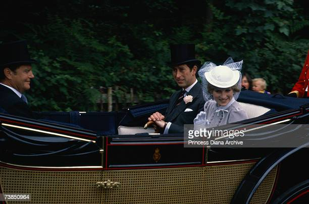 Lady Diana Spencer and her fiance Prince Charles ride in a carriage at the Royal Ascot race meeting June 1981 It is Diana's first visit to the Ascot...