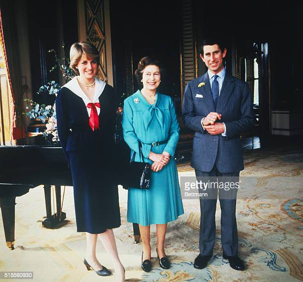 Lady Diana Spencer and Prince Charles pose with Queen Elizabeth at Buckingham Palace London in March 1981 the day that their wedding was sanctioned...