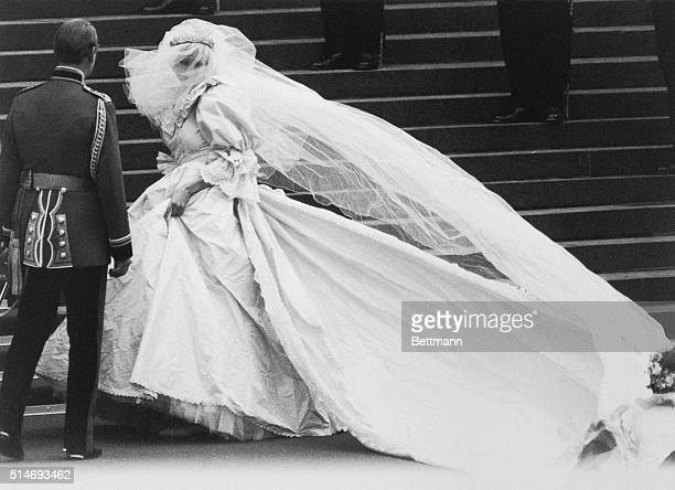 Lady Diana Spencer arrives at St Paul's Cathedral on her wedding day revealing to the world the wedding dress which had been carefully guarded during...