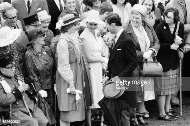 Lady Diana Spencer attends her first ever Garden Party at Buckingham Palace Pictured here talking with her husband to be Prince Charles as the guests...