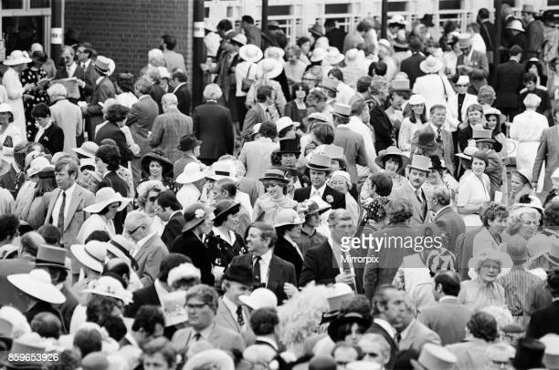 Lady Diana Spencer centre in the ribbon banded hat and striped top enjoys the day with some friends on the last day of Royal Ascot A few race goers...