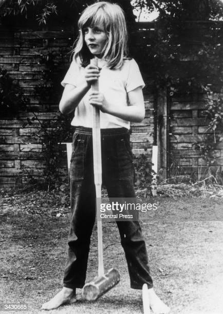 Lady Diana Spencer holding a croquet mallet during a game at Itchenor West Sussex