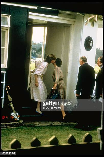 Lady Diana Spencer kissing her motherinlaw to be in greeting before going to watch fiance Prince Charles play polo