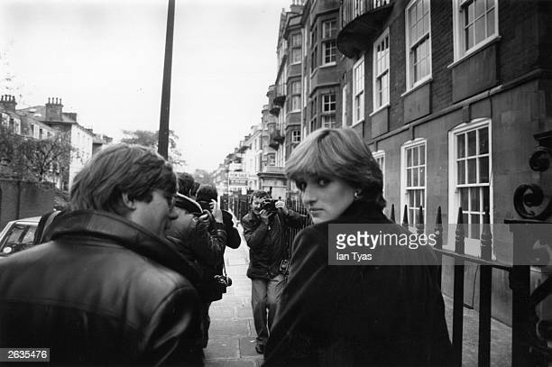 Lady Diana Spencer , surrounded by press photographers and reporter Howard Foster shortly before the announcement of her engagement to Charles,...