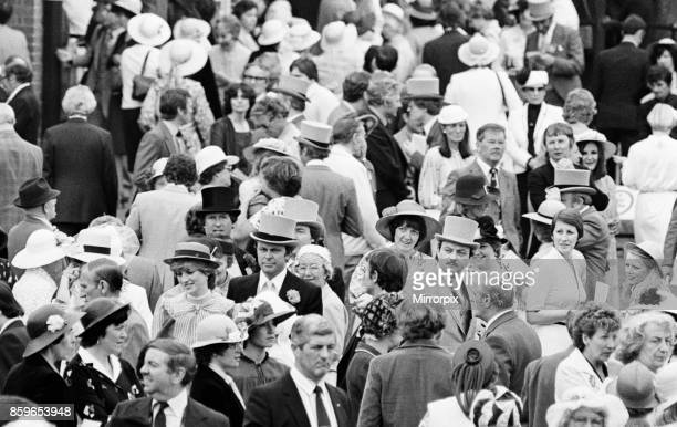 Lady Diana Spencer towards the bottom left in the ribbon banded hat and striped top enjoys the day with some friends on the last day of Royal Ascot A...