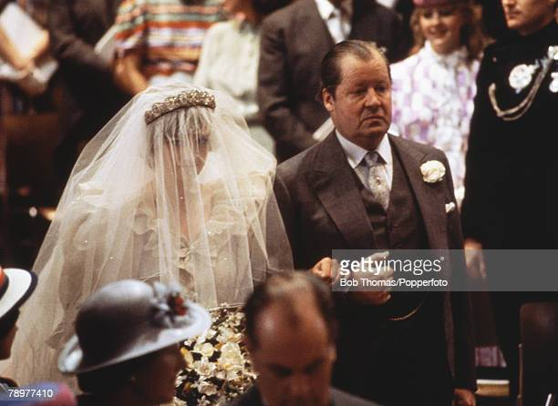 Lady Diana Spencer walks down the aisle with her father, the Earl Spencer, at her wedding to Prince Charles at St Pauls Cathedral, London, 29th July...