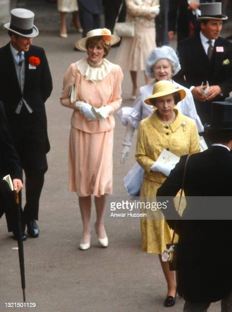 Lady Diana Spencer, wearing a peach coloured crepe suit with a wrap top jacket and cream ruffle neck blouse designed by Benny Ong and a yellow straw...