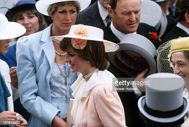 Lady Diana Spencer wearing a peach coloured outfit and boater attends Royal Ascot for the first time on June 03 1981 in London England