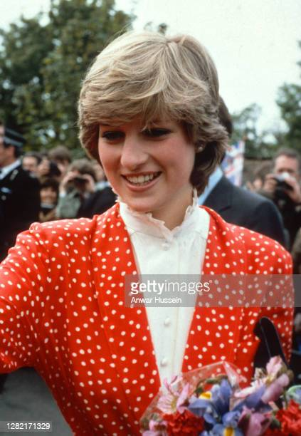 Lady Diana Spencer, wearing a red and white polka dot suit designed by Jasper Conran, attends her first walkabout with her fiance Prince Charles,...