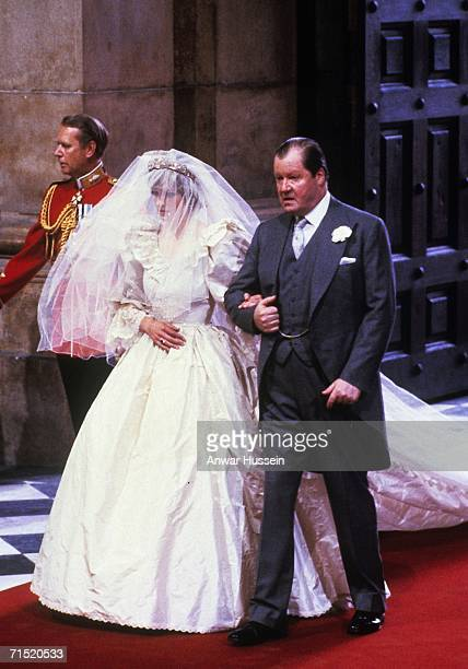 Diana Princess of Wales enters St Paul's Cathedral on the hand of her father Earl Spencer for her marriage to Charles Prince of Wales July 29 1981 in...
